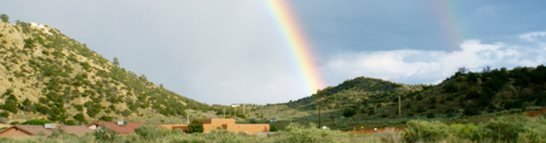 Photo of Arizona landscape with a double rainbow